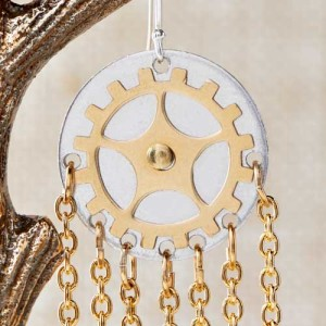 For these earrings, pierce additional holes in between the gears shown here. Cut 6 – one inch chain and attach to the hole with a jump ring. Add your earwire to the hole pierced on top.
