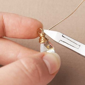 STEP 6: Cut excess wire with a side cutter and use flat nose pliers to tuck ends within coils.