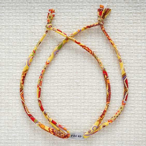 GoodyBeads.com Blog | Resolution Braceletes - Metal Stamping: How to tie Lycra cord for wrap around bracelet.
