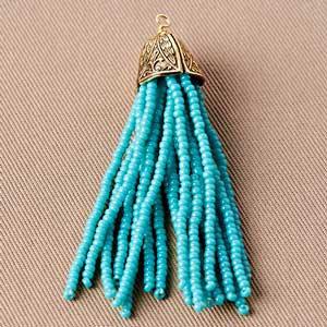 Step Eight: Add your bead cap or bead end and make a wire wrapped loop. You've completed your beaded tassel.