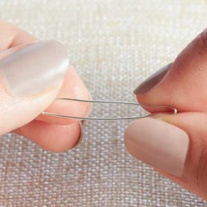 """Step 2. Cut 3"""" of 24-Gauge Artistic Wire and bend in half. Pinch the fold."""