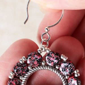 Step 10: Open a size 4mm jump ring and slide through the size 8/0 seed bead and the loop of your ear wire. Close jump ring.
